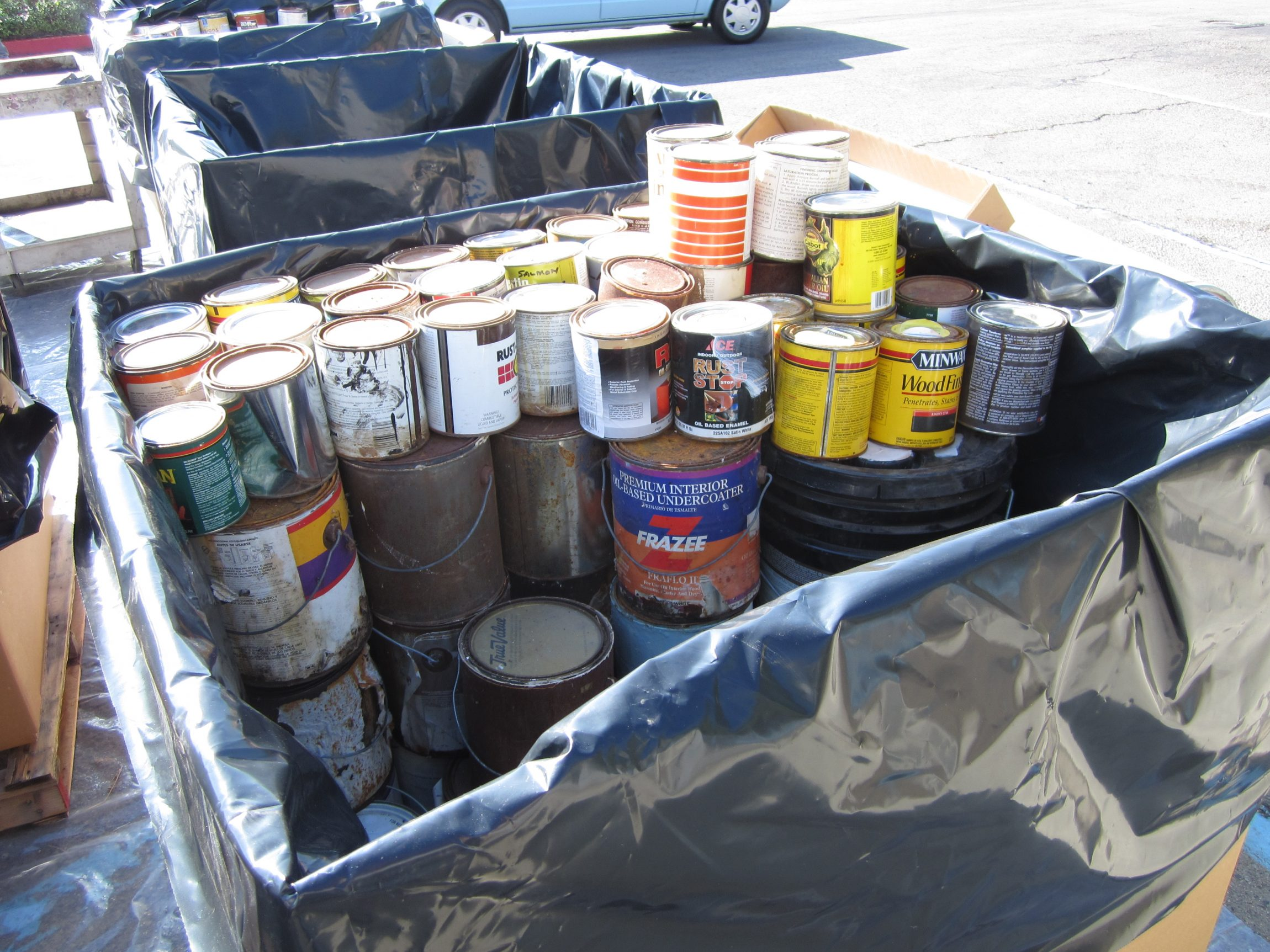 Common HHW items: paint, automotive fluids, fluorescent tubes, cleaning products, batteries and gardening chemicals.