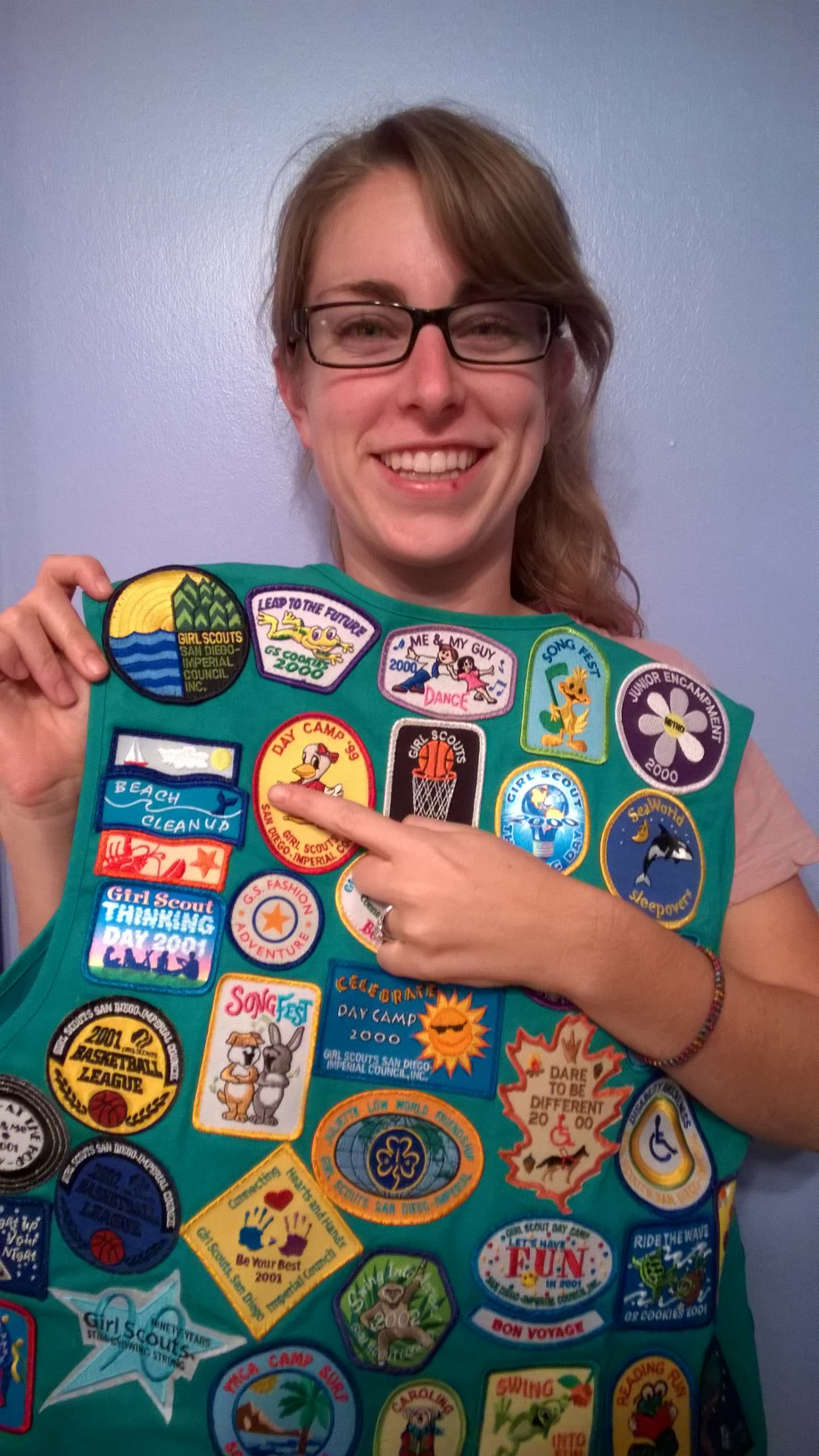 Emily poses proudly with her Girls Scout patch she received from ILACSD!